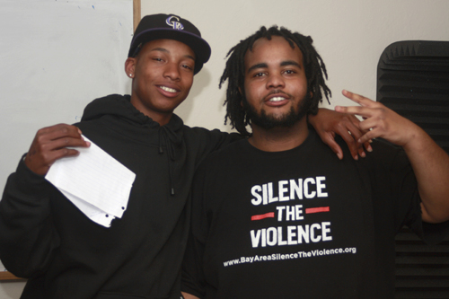 Two youth representing &quot;Silence the Violence&quot;