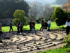 People walking in a labyrinth made of stones
